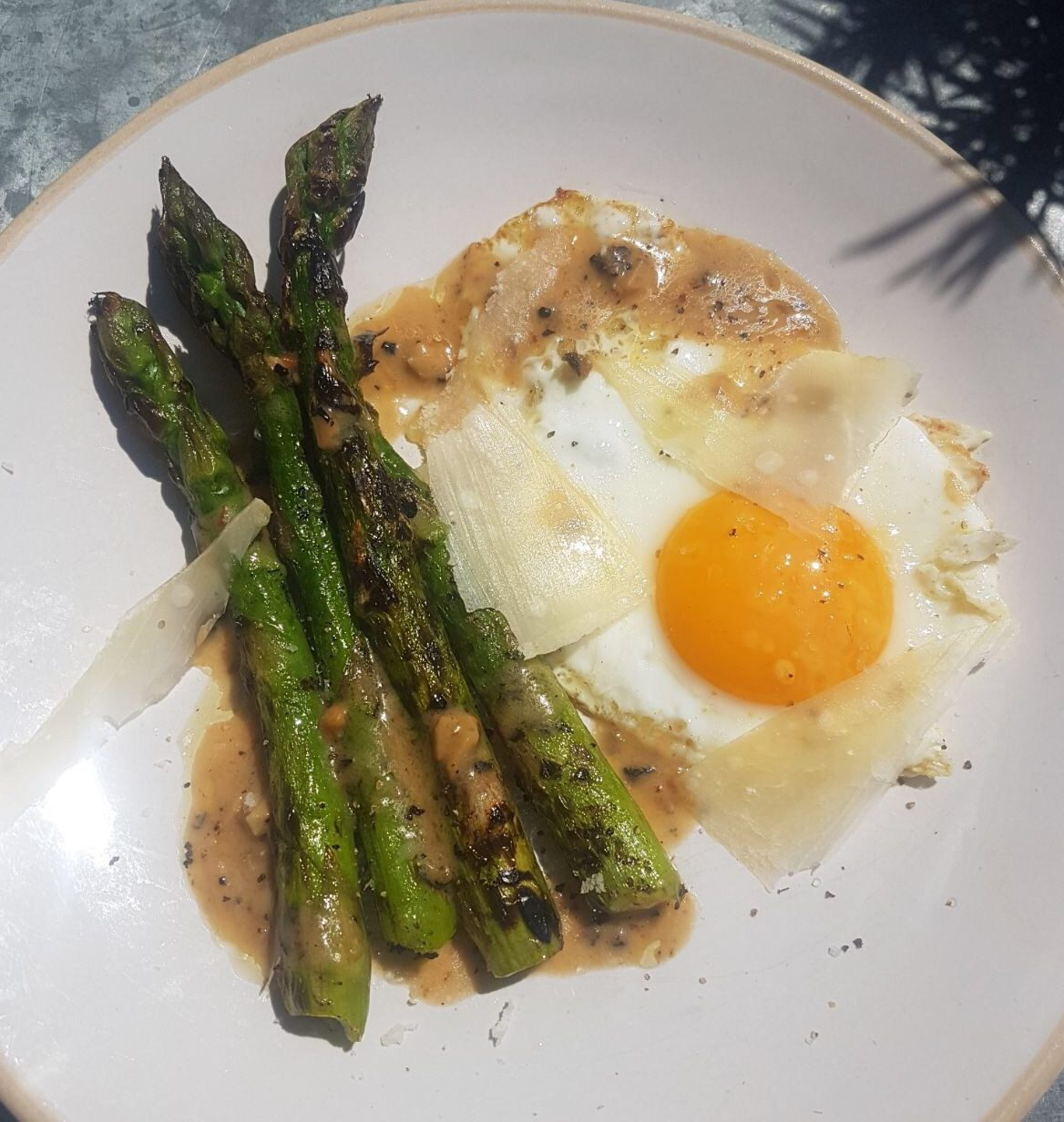 Asparagus with truffled fried egg and parmesan