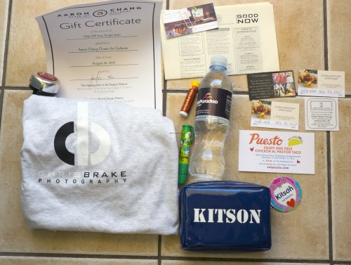 Free swag I scored. Chris Brake t-shirt, Kitson makeup bag, eraser stick, Yelp stick, coupons for free food.
