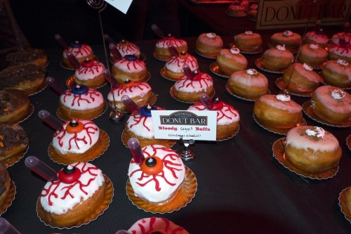 Raspberry filled alcoholic donuts. Pumpkin donut to the right.