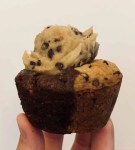 One brookie cupcake with cookie dough frosting