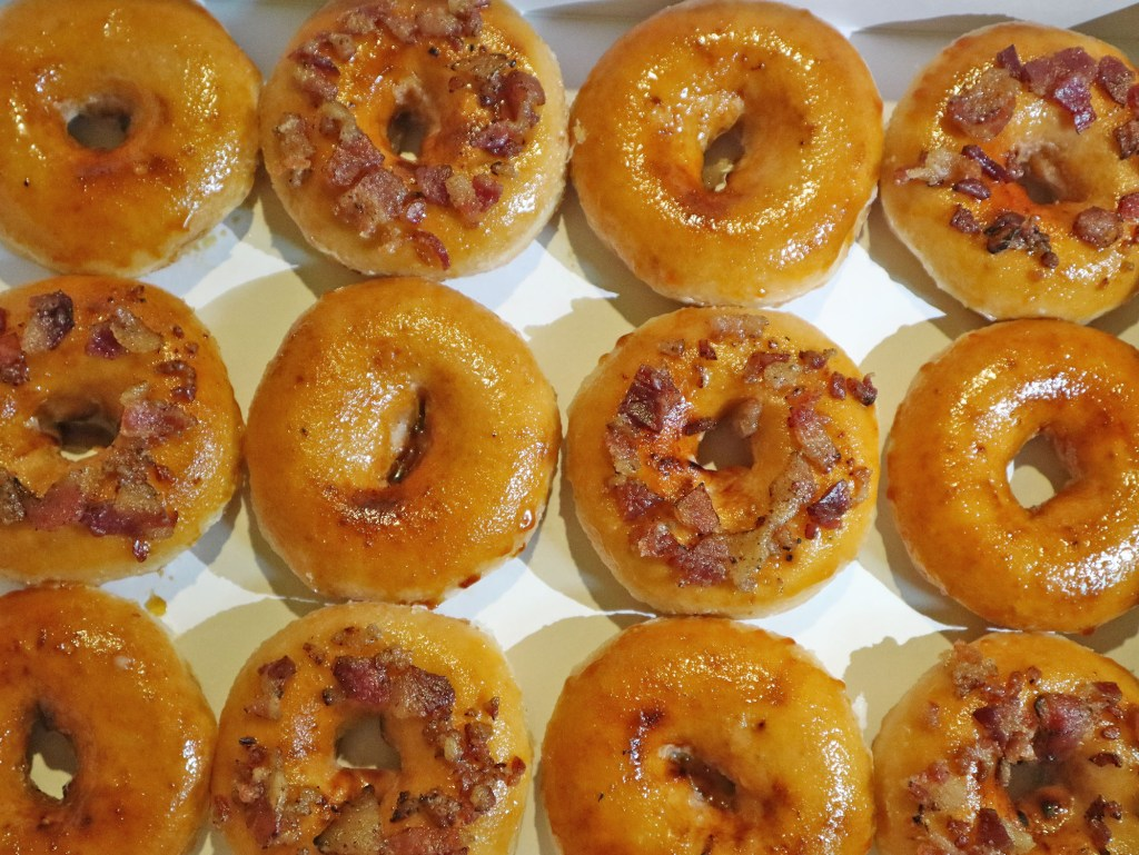 Krispy Kreme's Bacon and Cheese-Filled Ring Doughnut Flatlay