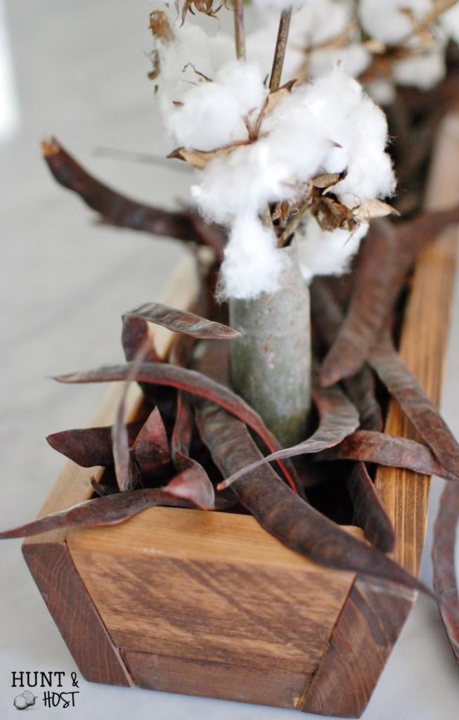 real cotton and jerusalem pea centerpiece
