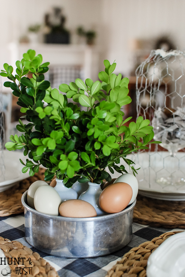 Easy Easter decorating ideas from a DIY chicken wire cloche tutorial to newspaper nests. All you need for the most beautiful spring tablescape.