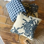 DIY dollhouse textile ideas. Cute dollhouse rugs, simple dollhouse pillow ideas and cute little DIY dollhouse curtains! Farmhouse style dollhouse accessories are easy and fun to make yourself! Part of the one room challenge!
