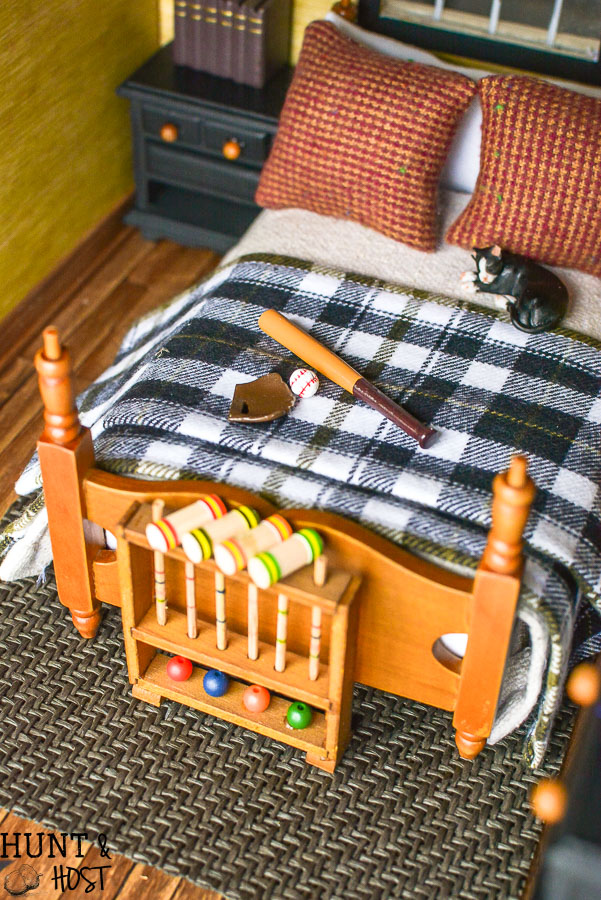 How precious is this rustic boys bedroom? These dollhouse bedroom ideas are perfect for the outdoor loving little boy, deer mount and all!