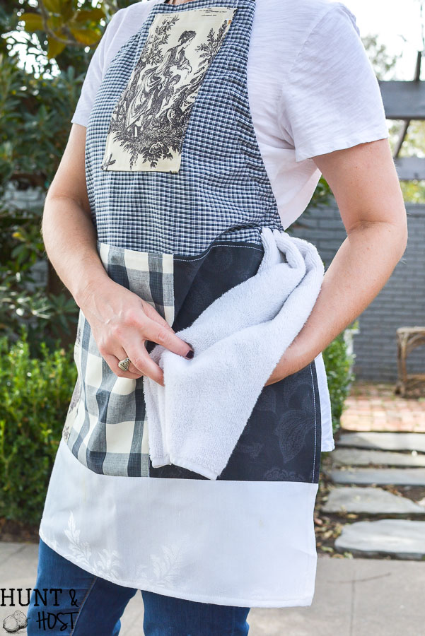 The perfect craft apron from fabric scraps, old clothes and linen closet toss outs. An easy pattern idea for how to make an apron from a shirt.This apron even has a cell phone pocket and hammer loop.