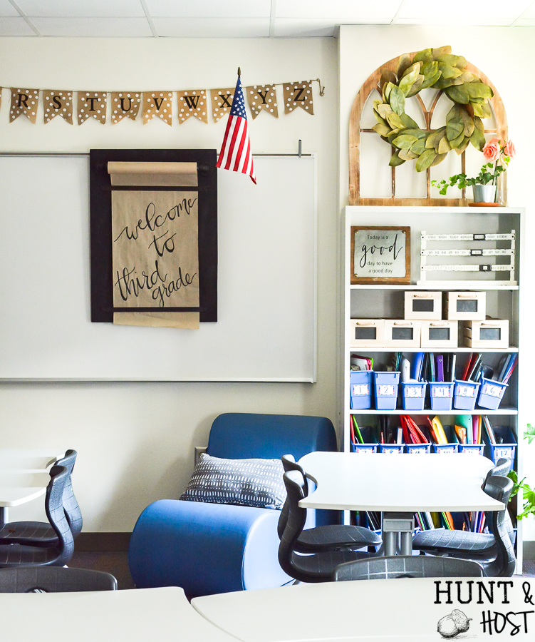 The cutest farmhouse classroom you ever saw. Visit this school room inspired by Magnolia Market and Joanna Gaines. It will have you wanting to pack a lunch and go back to school with it's fresh black and white decor and trendy farmhouse vibe. #farmhouseclassroom #farmhouseclassroomtheme #bulletinboard #farmhouseschool
