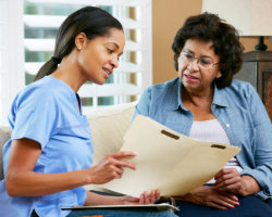 caregiver showing something to patient