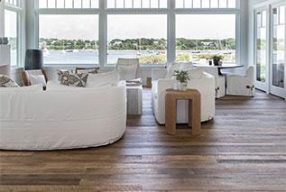 Resawn hardwood floor in living room with ocean view