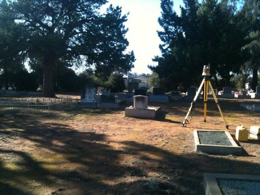 Hunter Geophysics use Topcon and Leica robotic total stations and RTK GPS systems to map cemeteries. This photo shows a Topcon total station on a tripod in a cemetery in northern Victoria.