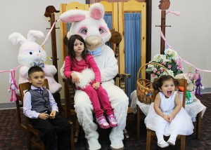 Easter bunny with children on lap