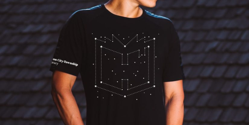 Man in black shirt with library constellation design on front