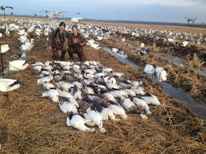 Great Arkansas snow goose hunt. Although this field looks wet the mud in Arkansas is nothing compared to the Missouri gumbo.
