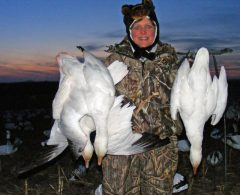 One of our many female hunters with some of the snow geese she harvested.