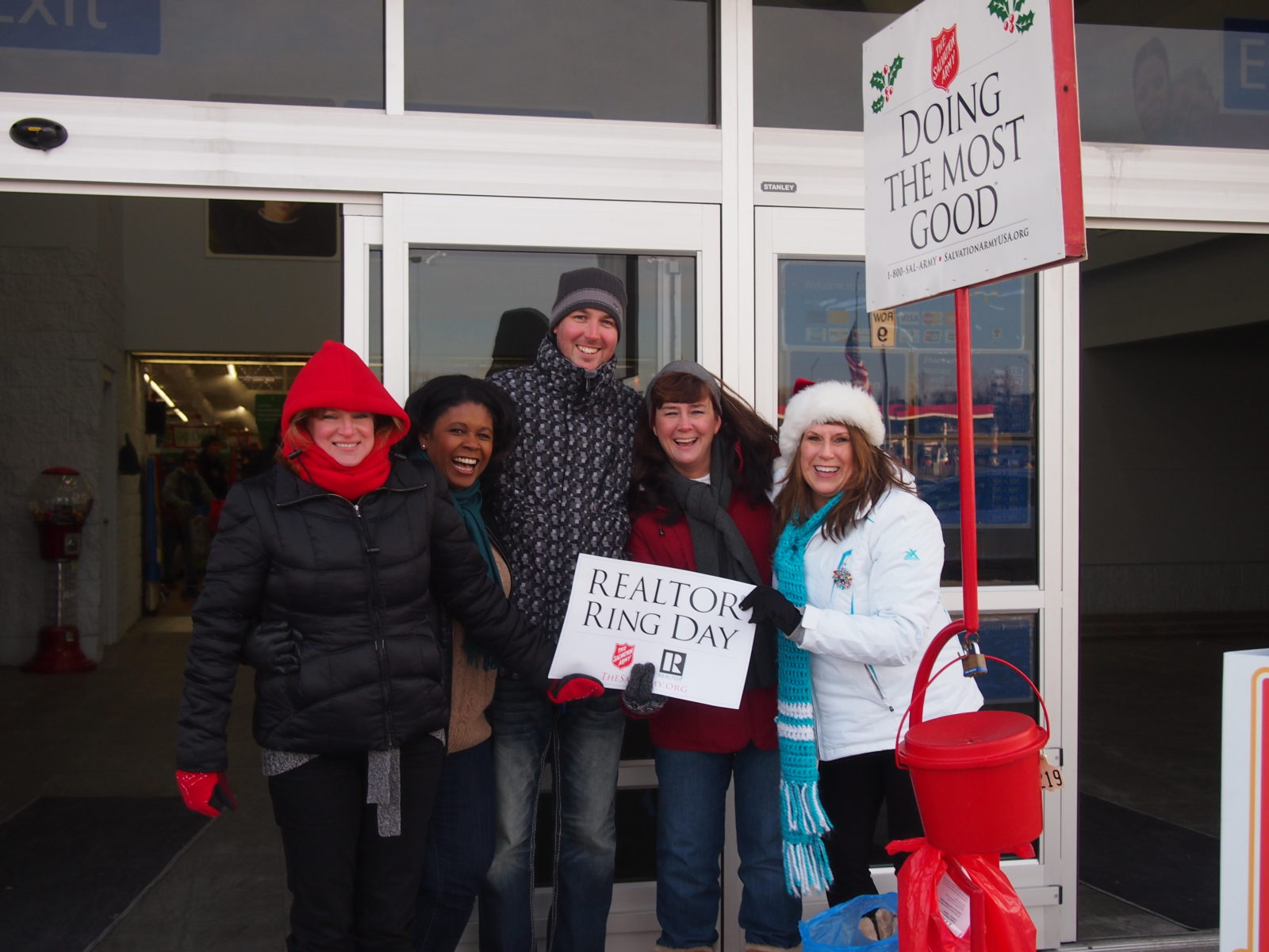 Omaha Bell Ringing Volunteers, Salvation Army, NP Dodge Real Estate, Husker Home Finders