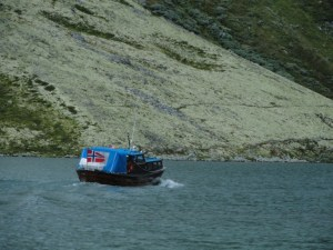 Boat heading to pick up guests, Den Norske Turistforening (DNT) at Rondvassbu Hut, hut2hut operational profile