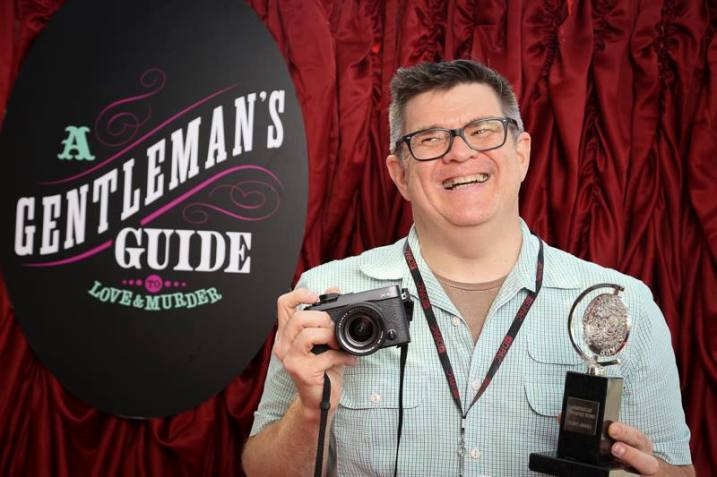 with a real Tony award during a photo station for DPAC in Durham NC