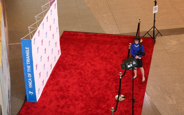Lydia ready to cover a step & repeat photo station for YMCA Triangle NC