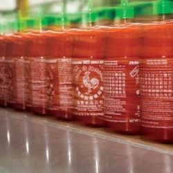 Huy-Fong-bottles-in-motion-560x315