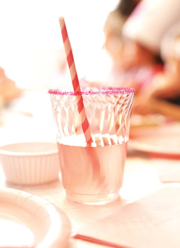 pink princess party with sugar rimmed cups and striped straws