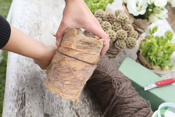recycled container and bark wedding centerpiece diy tutorial