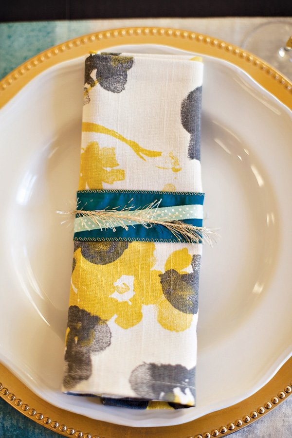 blue yellow and gold place setting