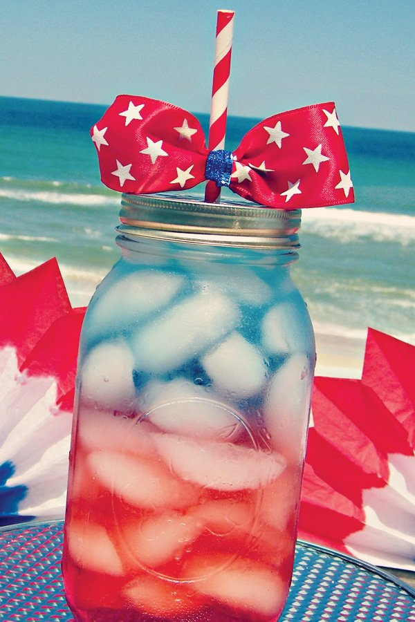 Red white & blue drinks in mason jars with star bow-tie topper