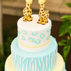 Sweet yellow and blue twins giraffe birthday cake