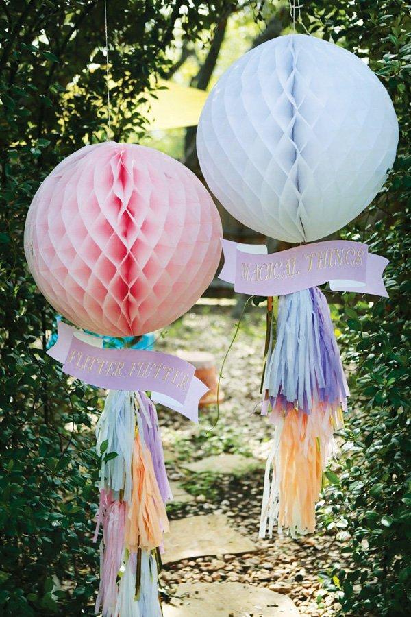diy honeycomb and tissue tassel garland hanging decor