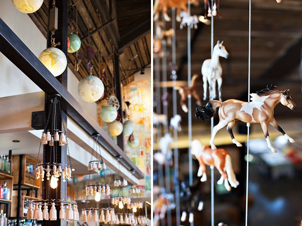 Cucina Enoteca interior decor with hanging globes and toy horses