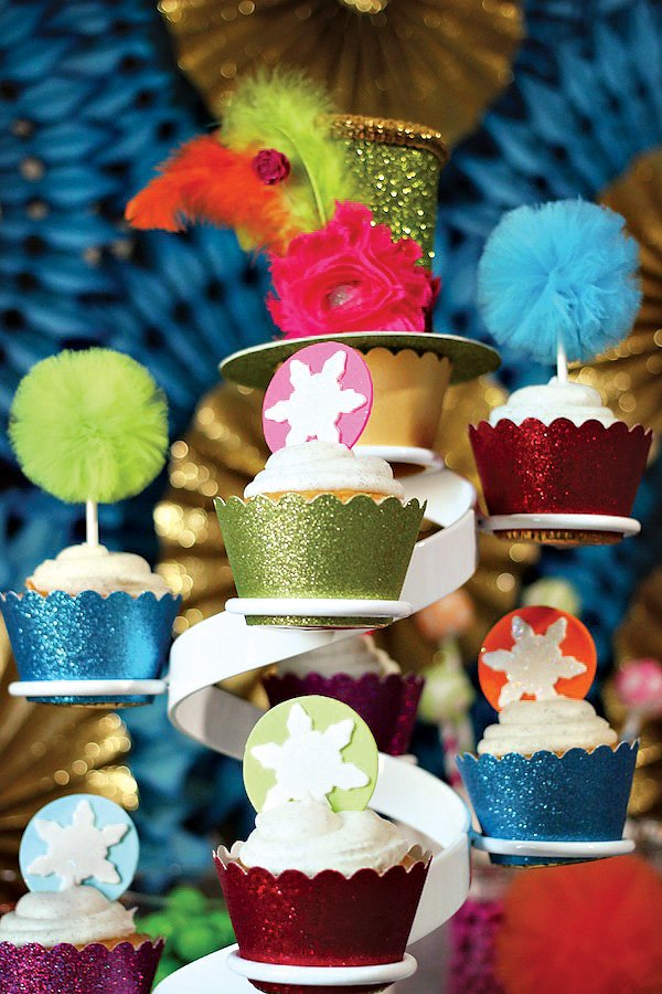 glittery christmas cupcake wraps on a whimsical cake stand