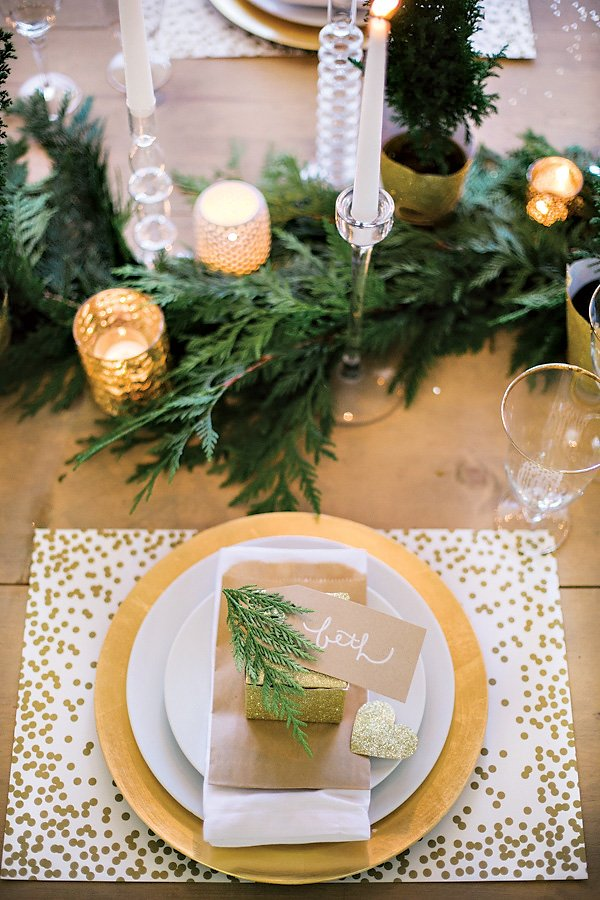 gold, glitter and white place setting and tablescape for a holiday christmas party