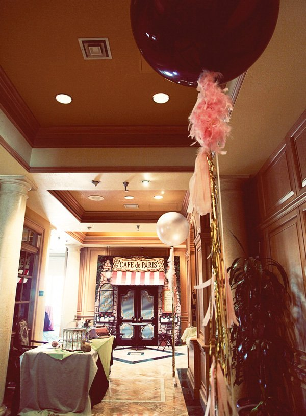 pink and gold popup paris cafe with alcove and giant balloons