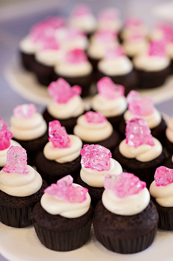 pink kryptonite topped chocolate cupcakes