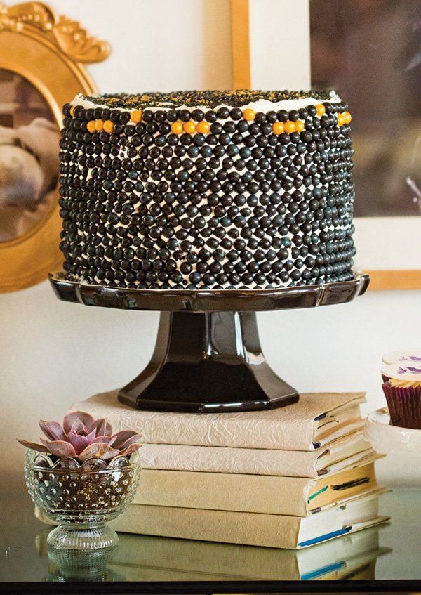 black and yellow sixlet covered modern cake