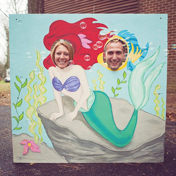 DIY painted ariel and flounder cut out photo booth