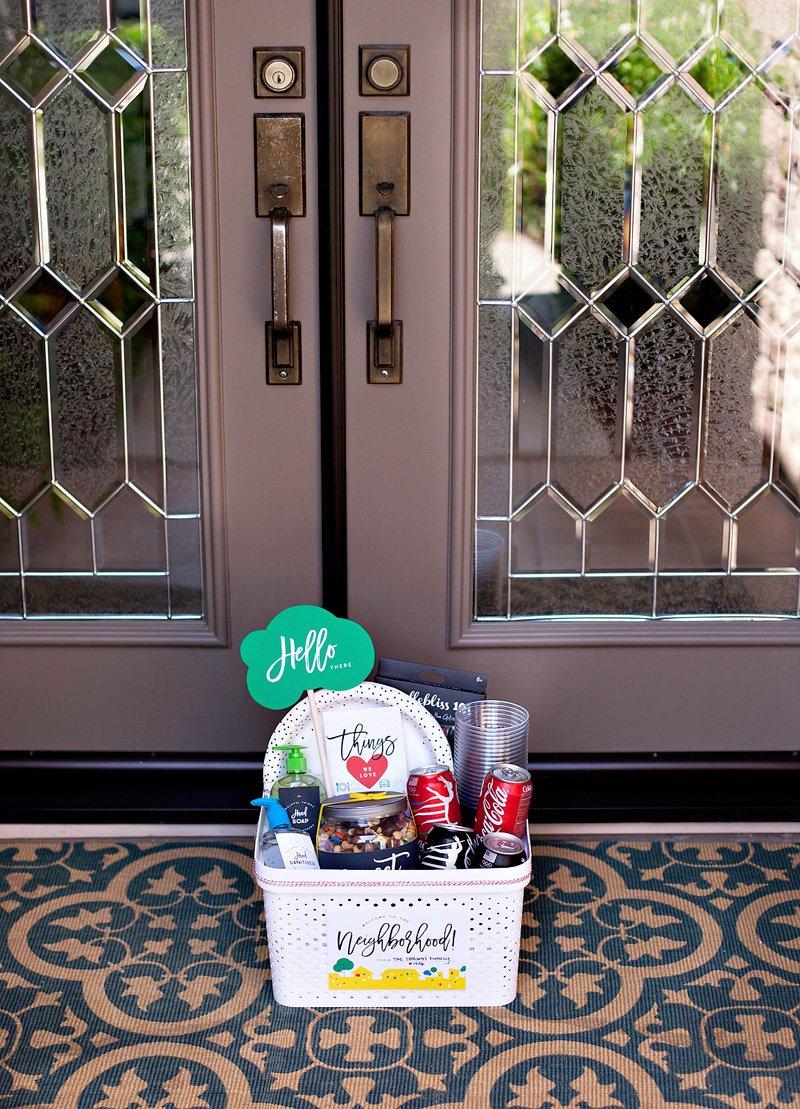 welcome neighbor basket at front door