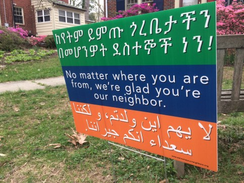 University Park welcome your neighbors lawn sign amharic arabic