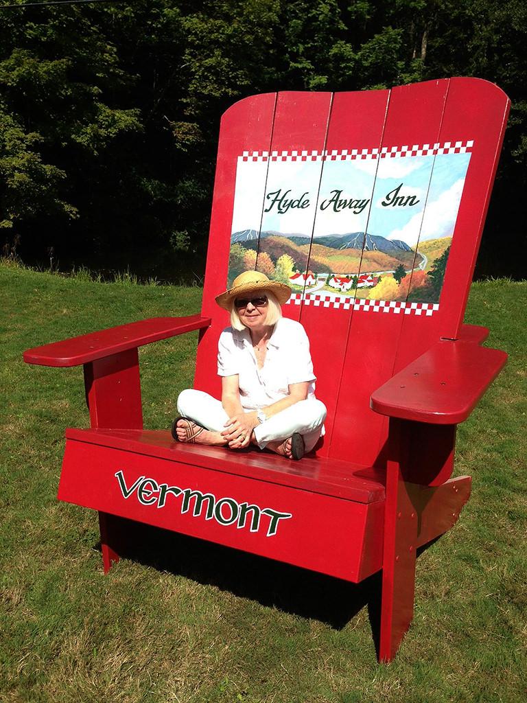 Artist, Ellen Crafton sitting in the Hyde Away Chair