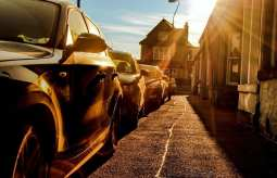 Solar electric car - Cars on raod in sunlight