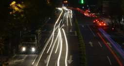 Hydrogen Fuel Cell Industry - Vehicles on road in Shanghai at night