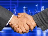 Hydrogen fuel cell technology - comapny acquisition - business handshake
