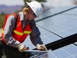 Renewable Energy Jobs - Man with solar panels