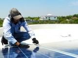 California home solar panels - man installing solar PV system on roof