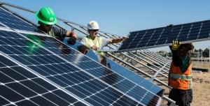 US Solar Installations - workers installing solar panels