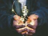 Clean electricity - Light bulb in hands