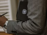 UN Sustainable Development Goals - Man holding folder with UN symbol