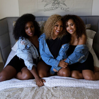 Three women with curly hair
