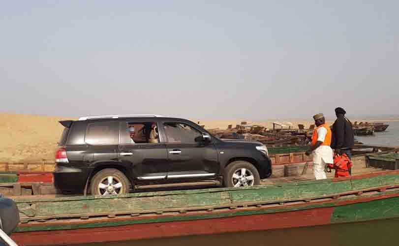 Photos: Sokoto State governor, Aminu Tambuwal, ferried inside his car across River Benue