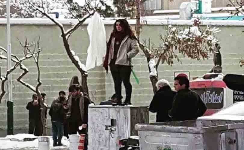 Iranian women put their scarves on sticks in the middle of busy streets to protest mandatory Hijab laws